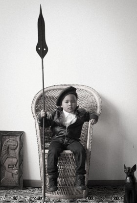 Child in wicker chair